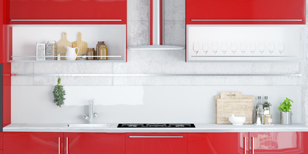 きれいな赤いキッチンでストーブと排気フードします。