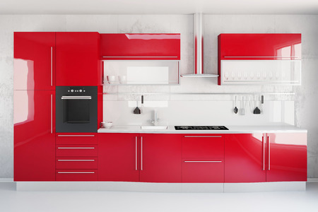 Interior of modern new red kitchen with stove and fridge
