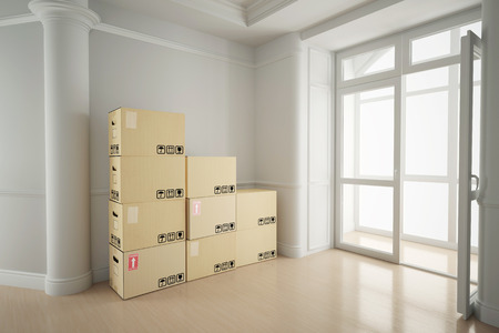 forwarding agency: White empty room in old house with moving boxes