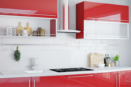 Interior of clean kitchen with modern red kitchenette Stock Photo