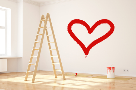Red heart painted on wall as symbol for love