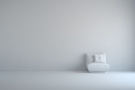 easy chair: Easy chair with pillows on white wall in an empty room
