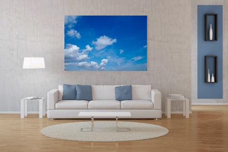 Modern inter uit een woonkamer met foto van de hemel met wolken op canvas