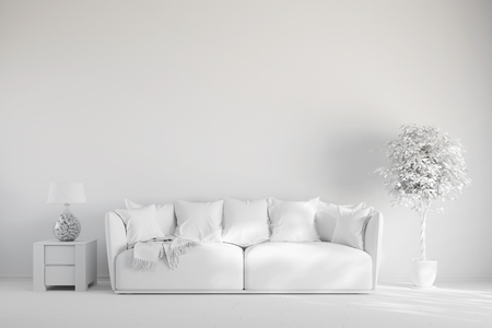 Living room with sofa in front of a wall in white