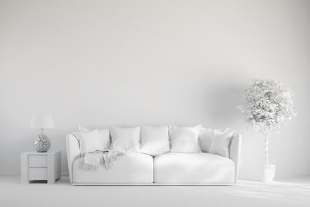 Woonkamer met een bank in de voorkant van een muur in het wit Stockfoto