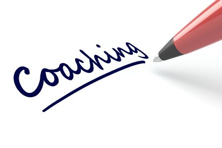 pen writing: Pen writing the word Coaching on a white piece of paper Stock Photo