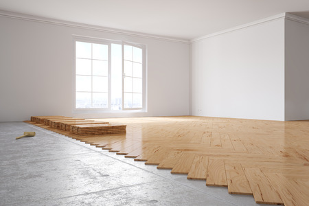 Laying out poplar hardwood in room in a house Stockfoto