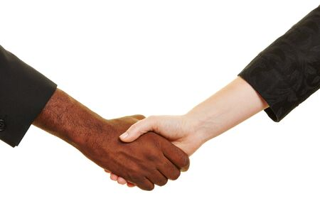 african business: Handshake between african and european business people