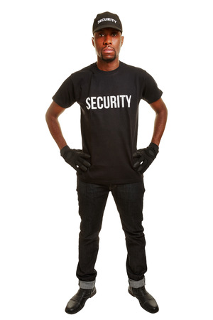 usher: Security guard from security firm standing with arms akimbo Stock Photo