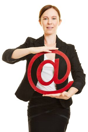 business symbol: Business woman holding big red at sign as email symbol
