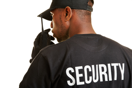 Security guard from behind talking into radio set