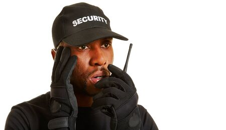 usher: Man as security guard giving alarm with his radio set