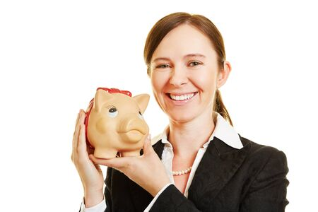 thrift box: Smiling business woman with a piggy bank in her hands