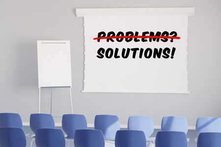 business problems: Solutions instead of problems on whiteboard in a business seminar room