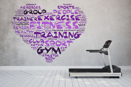 tag cloud: Treadmill at home with heart shaped fitness tag cloud on concrete wall Stock Photo