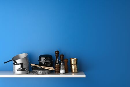 Household goods and kitchenware on shelf in kitchen in front of a blue wall (3D Rendering)