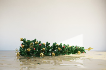 household insurance: Tipped decorated christmas tree floating in flooded room