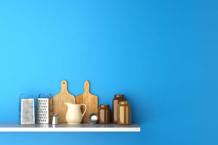 Shelf in kitchen with cutting boards and kitchenware on a blue wall (3D Rendering) Stock Photo