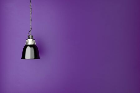 room wall: Lamp hanging in front of a purple wall in living room (3D Rendering) Stock Photo