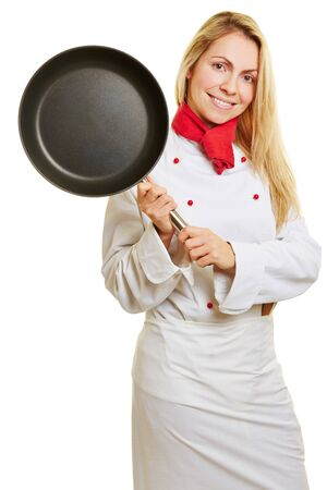 apprenticeship: Smiling woman as cook in apprenticeship holding a frying pan Stock Photo