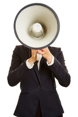 speaking tube: Anonymous businesswoman holding megaphone in front of her face