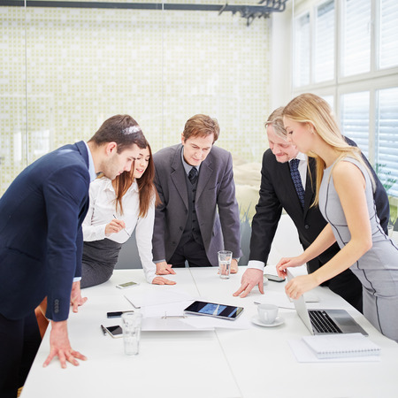 team planning: Business team with tablet in a meeting planning Stock Photo