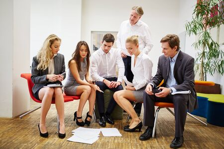 group strategy: Group of business people as a team during a strategy meeting