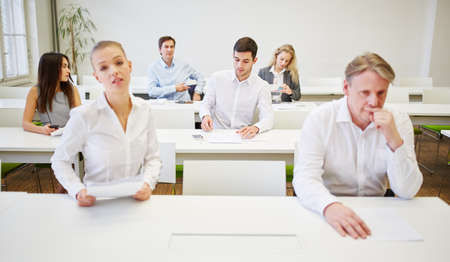 bad planning: Worried business people before a test in a business seminar Stock Photo