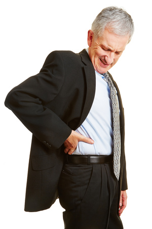pangs: Old business man having back pain and holding hand to his aching back