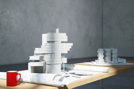 floorplan: Blueprint and architectural model on desk in office of an architect (3D Rendering)