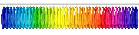clothes rail: Many shirts assorted in rainbow colors on a long clothes rack (3D Rendering) Stock Photo