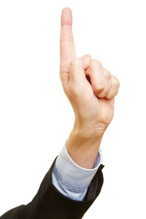 admonish: Businessman holding index finger up as a warning sign Stock Photo