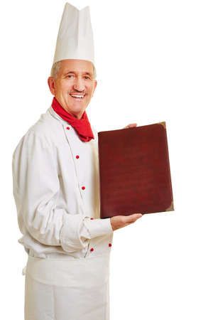 workwear: Smiling chef cook in workwear offering menu Stock Photo