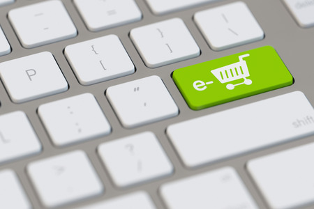 electronically: Shopping cart as symbol for e-Commerce online at computer (3D Rendering) Stock Photo