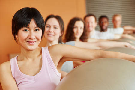 gym ball: Woman with gym ball in pilates class at fitness studio Stock Photo