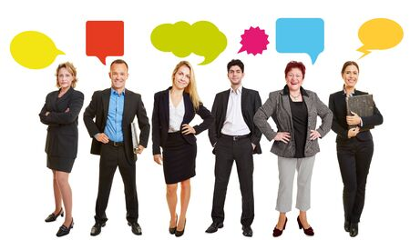Business people with speech bubbles in a group photo