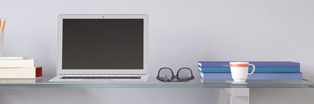 Open laptop computer with empty screen at desk in office (3D Rendering)