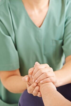 patient care: Holding hands of senior woman for consolation and condolence Stock Photo
