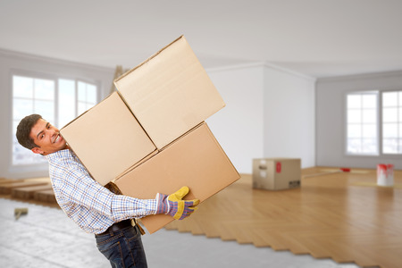 Man from moving company with many boxes in his hands photo