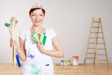 color consultant: Happy woman with brushes and different colors painting wall in a room (3D Rendering)