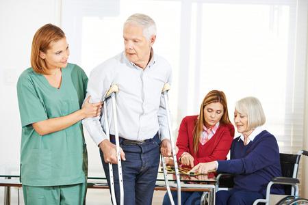geriatric: Geriatric caregiver with senior people in nursing home