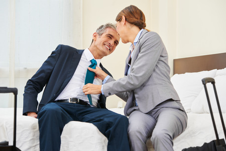 love affair: Two business people having an affair in a hotel room Stock Photo