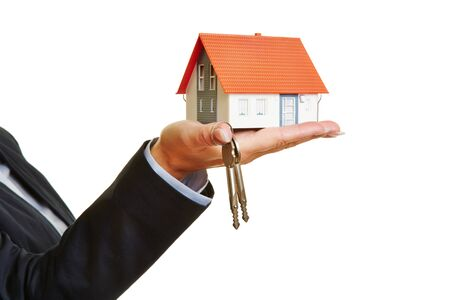 apartment for rent: Hand holding house and keys as concept for real estate financing