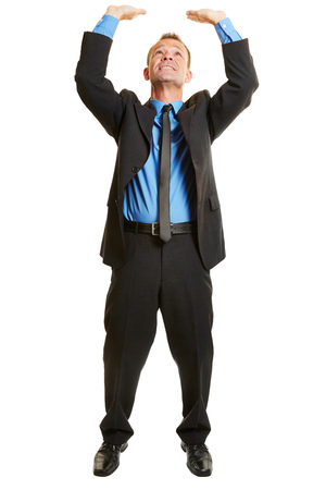 Isolated full body business man lifting an imaginary object Stock Photo