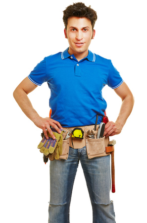 Smiling craftsman with a tool belt Stock Photo