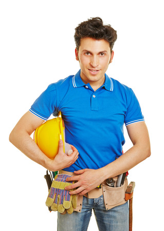 Construction worker with hardhat and tool belt in front view Stock Photo