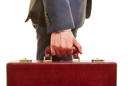 briefcase: Hand of business manager holding handle of a briefcase