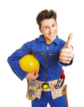 boiler suit: Happy worker with hardhat and tool belt holding his thumbs up Stock Photo