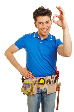 okay: Happy craftsman showing okay gesture with his hand