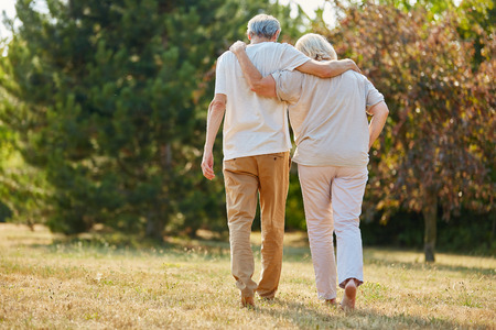 inseparable: Two seniors in love walking in the nature in summer Stock Photo
